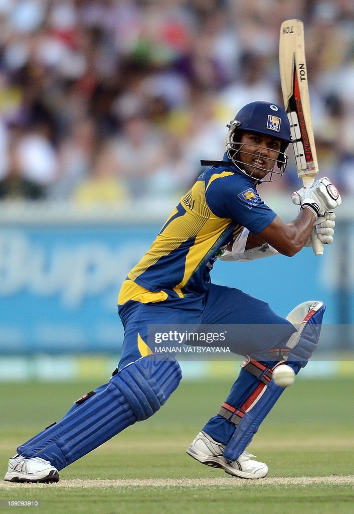 Sri Lankan batsman Dinesh Chandimal plays a shot during the first one-day international between Australia and Sri Lanka at the Melbourne Cricket Ground on January 11, 2013. AFP PHOTO/ MANAN VATSYAYANA USE