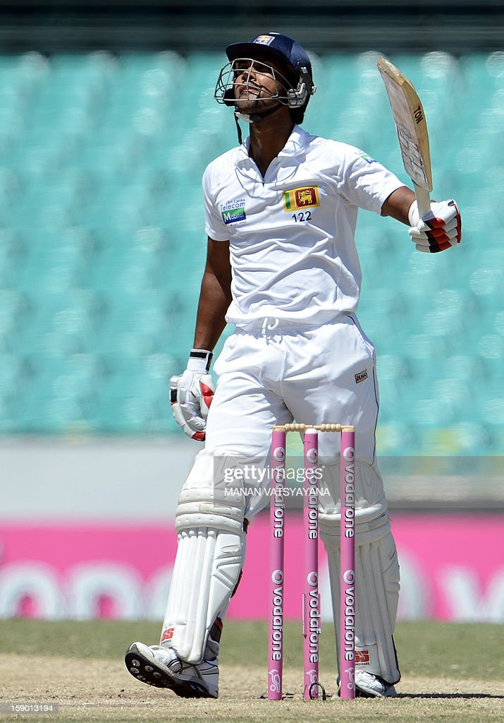 Sri Lankan batsman Dinesh Chandimal reacts after completing his half-century (50 runs) on the fourth day of the third cricket Test match between Australia and Sri Lanka at the Sydney Cricket Ground on January 6, 2013.