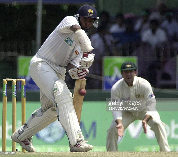 Sri Lankan batsman Hashan Tillakaratne bats as Australian captian Ricky Ponting looks on during the third day of the final test match between Sri...