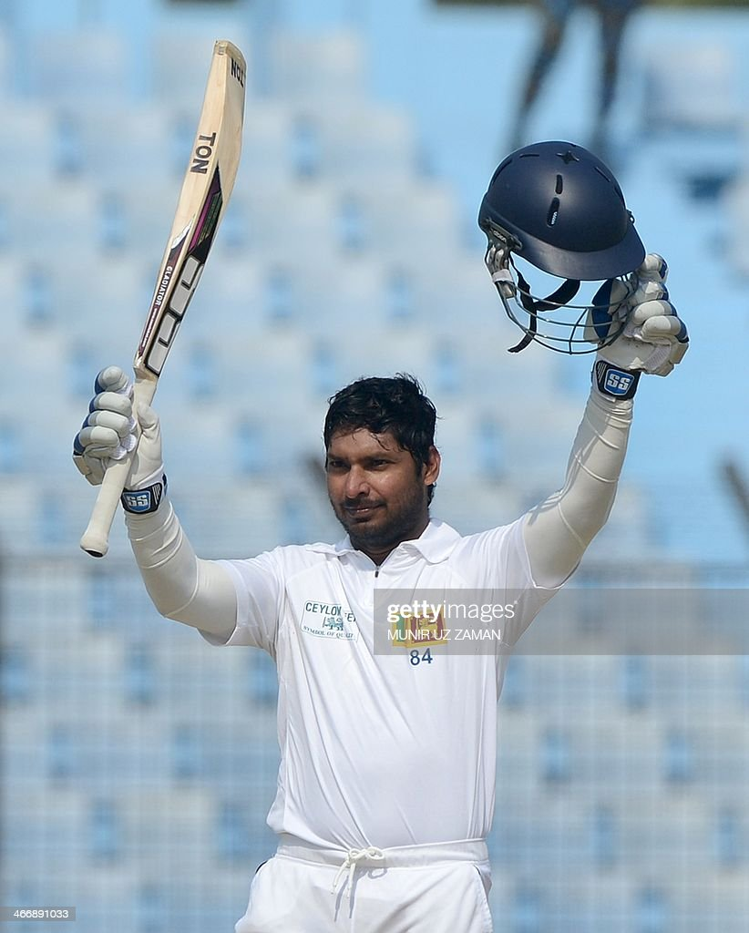 Sri Lankan batsman Kumar Sangakkara acknowledges the crowd after scoring a double century during the second day of the second Test match between...