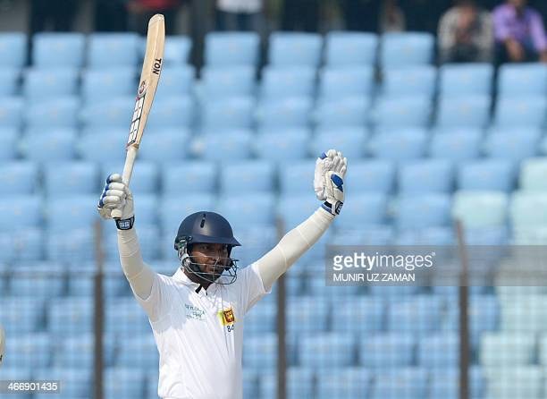 Sri Lankan batsman Kumar Sangakkara acknowledges the crowd after scoring a triple century during the second day of the second Test match between...