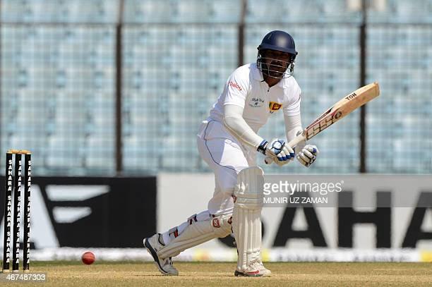 Sri Lankan batsman Kumar Sangakkara plays a shot during the fourth day of the second Test match between Bangladesh and Sri Lanka at The Zahur Ahmed...