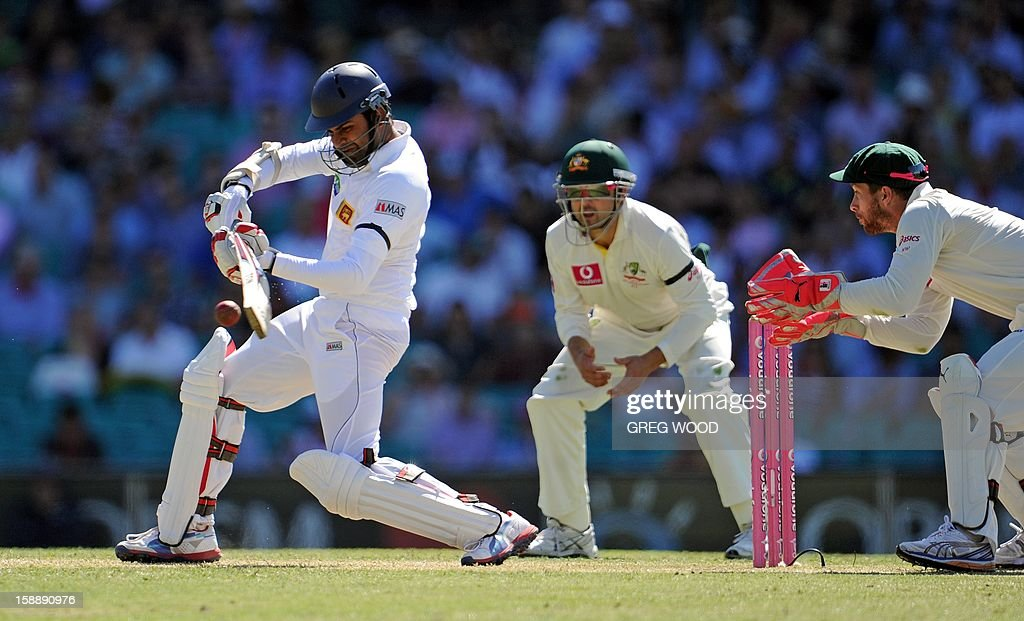 Sri Lankan batsman Lahiru Thirimanne (L) plays a shot on day one of the third cricket Test between Sri Lanka and Australia at the Sydney Cricket Ground on January 3, 2013. IMAGE STRICTLY RESTRICTED TO EDITORIAL USE - STRICTLY NO COMMERCIAL USE AFP PHOTO / Greg WOOD