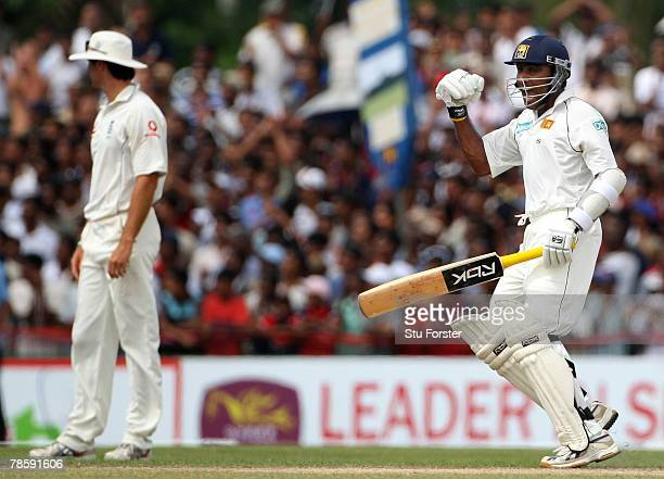 Sri Lankan batsman Mahela Jayawardene celebrates reaching his 200 as England captain Michael Vaughan looks on during day 3 of the 3rd and final Test...