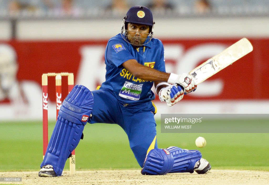 Sri Lankan batsman Mahela Jayawardene hits a reverse sweep against the Australian bowling during their Twenty20 match played at the Melbourne Cricket Ground (MCG), in Melbourne on January 28, 2013. AFP PHOTO/William WEST USE
