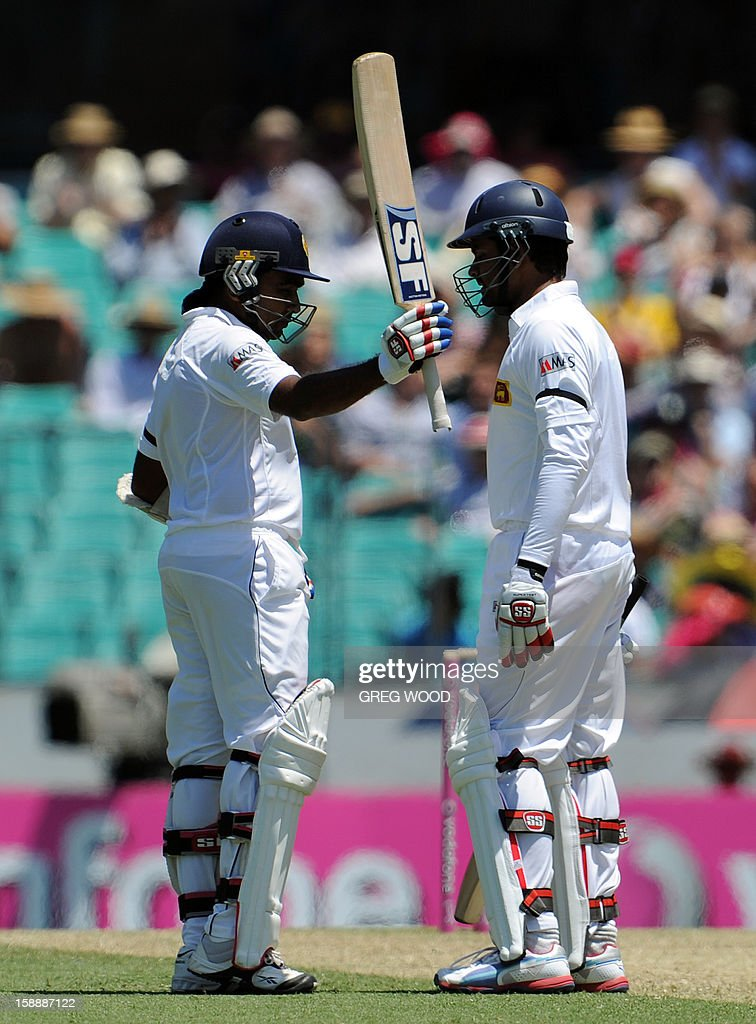 Sri Lankan batsman Mahela Jayawardene (L) with teammate Lahiru Thirimanne (R), waves his bat after reaching his 50 on day one of the third cricket Test between Sri Lanka and Australia at the Sydney Cricket Ground on January 3, 2013. IMAGE STRICTLY RESTRICTED TO EDITORIAL USE - STRICTLY NO COMMERCIAL USE AFP PHOTO / Greg WOOD