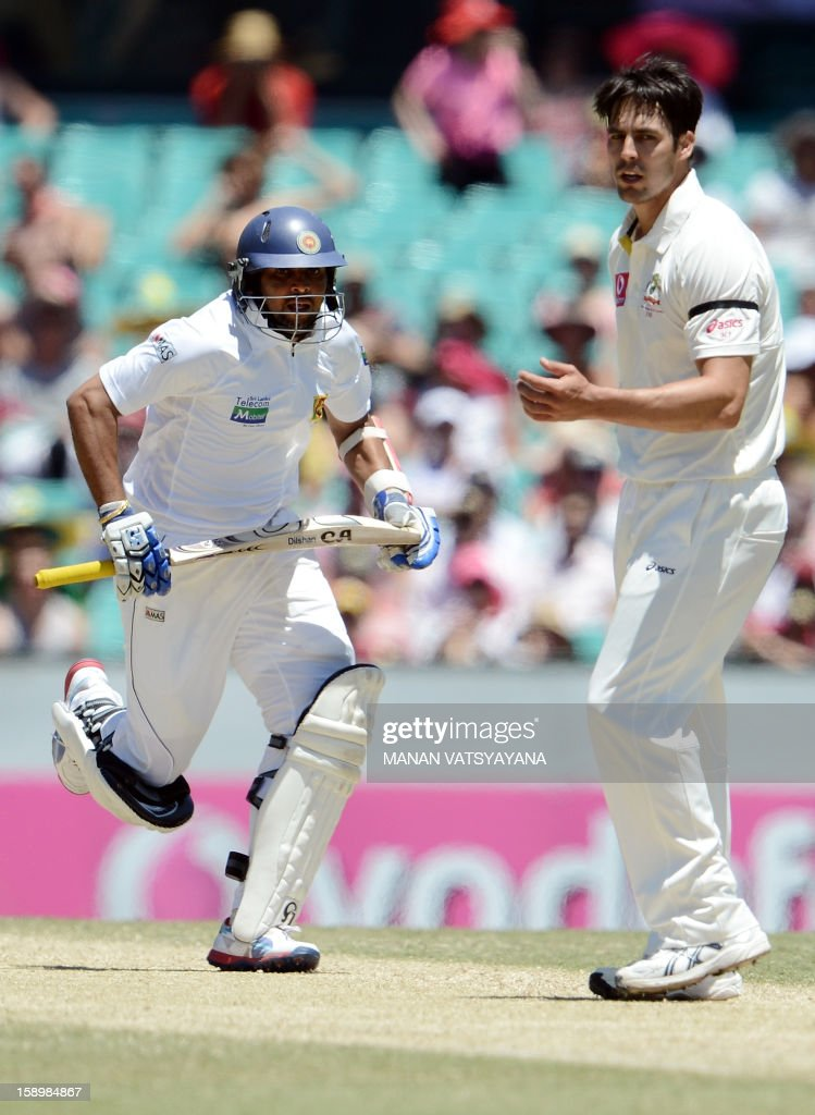 Sri Lankan batsman Tilakaratne Dilshan (R) takes a run past Australia's Mitchell Johnson (R) on day three of the third cricket Test match between Australia and Sri Lanka at the Sydney Cricket Ground on January 5, 2013.