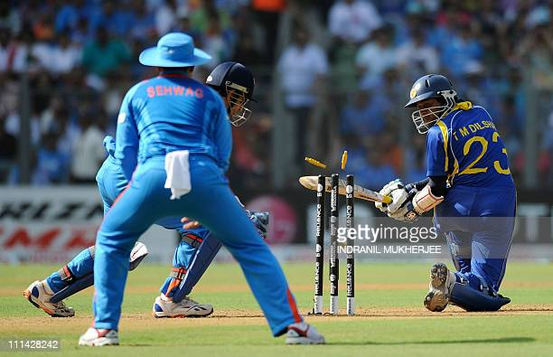 Sri Lankan batsman Tillakaratne Dilshan looks back as he is bowled out by unseen Indian spinner Harbhajan Singh during the ICC Cricket World Cup...
