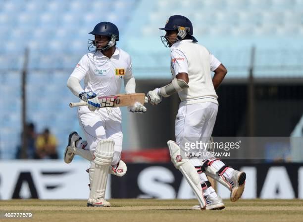 Sri Lankan batsmen Kumar Sangakkara and Mahela Jayawardene run between the wickets during the first day of the second Test match between Bangladesh...