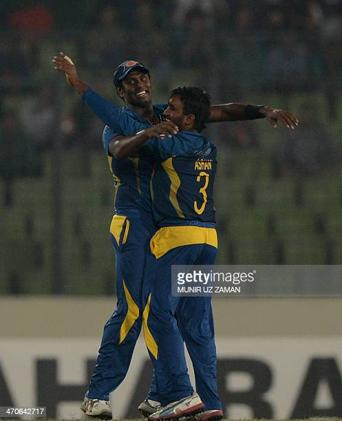 Sri Lankan bowler Ashan Priyanjan celebrates with his captain Angelo Mathews after the dismissal of Bangladesh batsman Shakib Al Hasan during the...