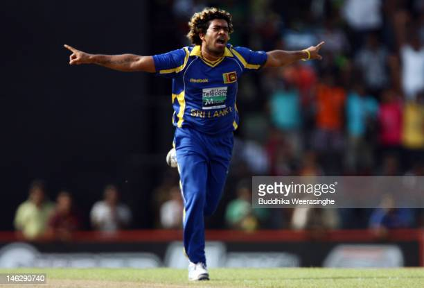 Sri Lankan bowler Lasith Malinga celebrates taking the wicket of Pakistan batsman Mohammad Hafeez during the third one day international match...