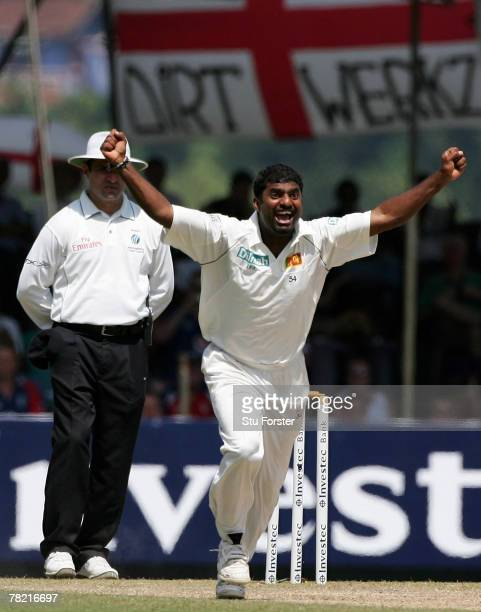 Sri Lankan bowler Muttiah Muralitharan celebrates after taking his World Record 709th Test wicket that of England batsman Paul Collingwood during the...