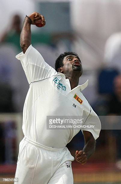 Sri Lankan bowler Muttiah Muralitharan delivers a ball to England batsman Alastair Cook during the fifth and final day of the third and final Test...