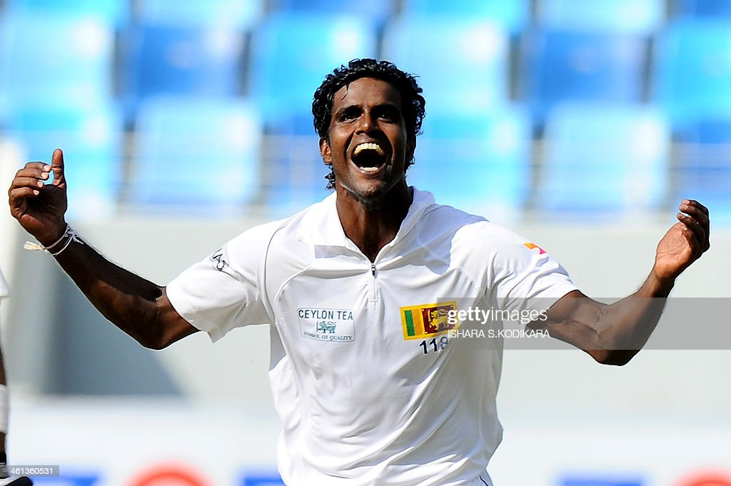 Sri Lankan bowler Shaminda Eranga celebrates after dismissing Pakistan cricket team captain Misbah-ul-Haq during the opening day of the second cricket Test match between Pakistan and Sri Lanka at the Dubai International Cricket Stadium in Dubai on January 8, 2014. AFP PHOTO/Ishara S. KODIKARA