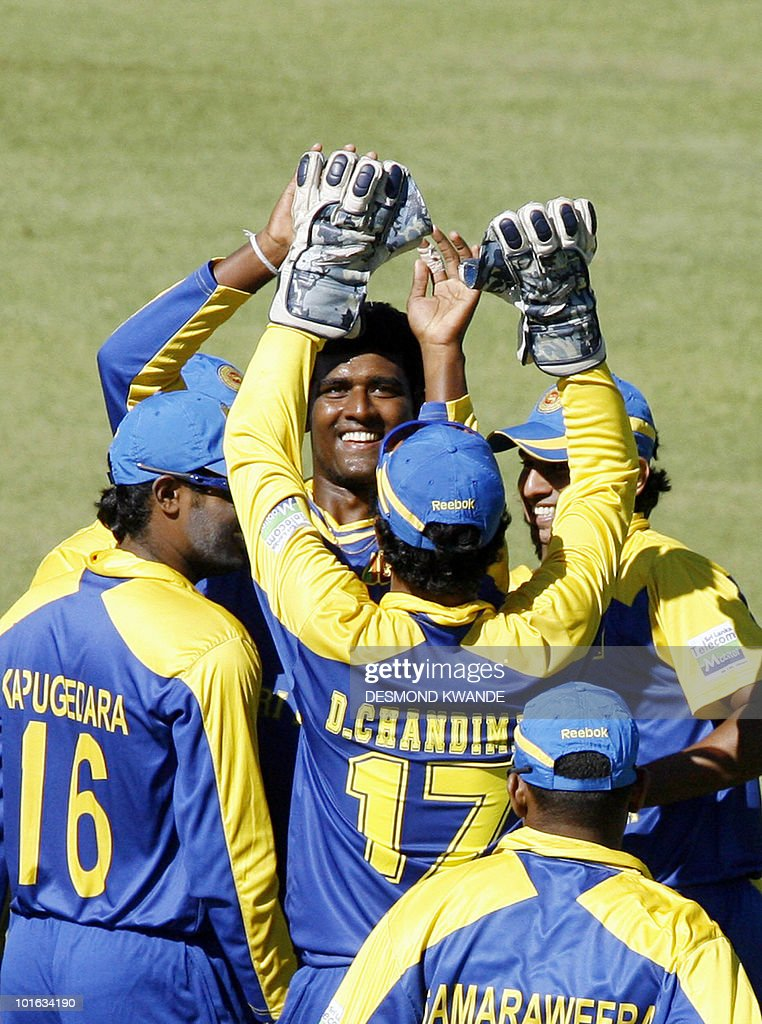 Sri Lankan bowler Thissara Perera and his team mates celebrate after he took the wicket of Indian batsman Dinesh Karthik at Harare Sports Club on June 5, 2010 in the fifth match of the Micromax Cup Triangular One-Day series which is being hosted by Zimbabwe. AFP PHOTO / Desmond Kwande