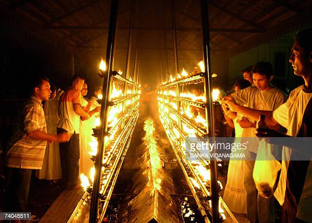 Sri Lankan Buddhist devotees light oil lamps at a temple in Kelaniya District of Colombo late 01 May 2007 as part of celebrations for The Wesak...