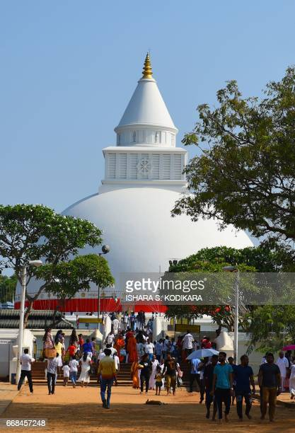 Sri Lankan Buddhist devotees walk at Kiri Veher Buddhist Temple in celebration of the traditional Sinhala and Tamil New Year at Kataragama on April...