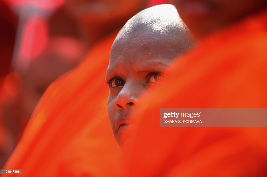 A Sri Lankan Buddhist monk takes part in a rally calling for a ban on Islamic halal-slaughtered meat at Maharagama, a suburb of the capital Colombo, February 17, 2013. A new group known as the Bodu Bala Sena, or Buddhist Force, launched a drive to press for a boycott of all halal products in a country where the majority are Buddhists. AFP PHOTO/Ishara S
