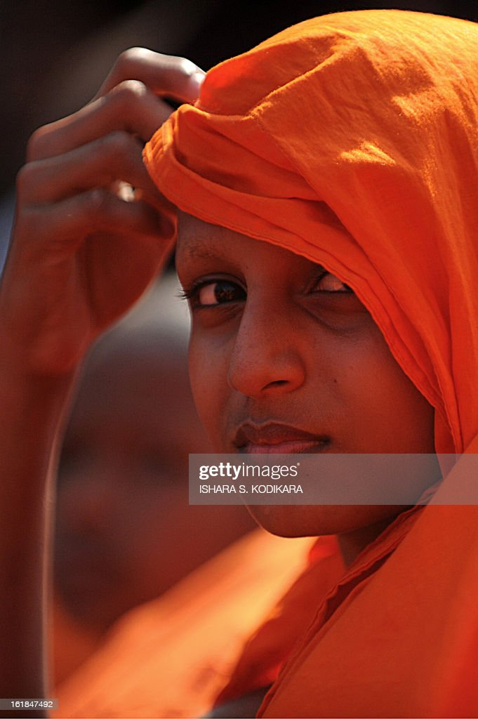 A Sri Lankan Buddhist monk takes part in a rally calling for a ban on Islamic halal-slaughtered meat at Maharagama, a suburb of the capital Colombo, February 17, 2013. A new group known as the Bodu Bala Sena, or Buddhist Force, launched a drive to press for a boycott of all halal products in a country where the majority are Buddhists. AFP PHOTO/Ishara S.KODIKARA