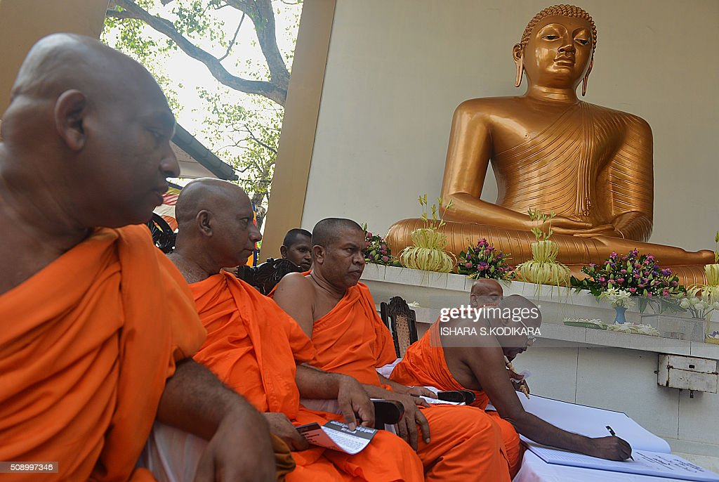 Sri Lankan Buddhist monks sign a petition in Colombo on February 8, 2016 against a UN-mandated investigation into alleged war crimes during the final stages of the islands Tamil separatist war. Former president Mahinda Rajapakse and his brother on February 8 denounced a visit by UN human rights chief Zeid Ra'ad Al Hussein to Sri Lanka as a 'big joke' and renewed their opposition to a UN-mandated war crimes probe. AFP PHOTO/ Ishara S. KODIKARA / AFP / Ishara S.KODIKARA
