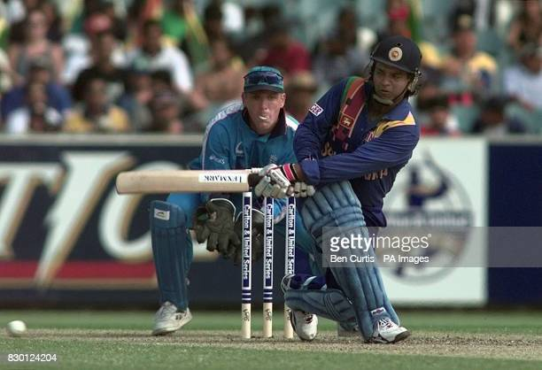 Sri Lankan Captain Arjuna Ranatunga sweeps a ball from England's Robert Croft prior to being caught out by Graeme Hick just after scoring a...