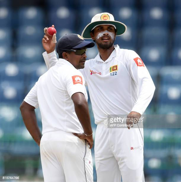 Sri Lankan captain Dinesh Chandimal and Rangana Herath looks on during the Third day of the only oneoff Test match between Sri Lanka and Zimbabwe at...
