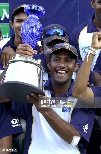 Sri Lankan captain Hashan Tillakaratne holds aloft the series trophy afterhis side thrashed England in the third and decisive final test at the...