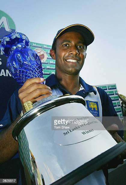 Sri Lankan captain Hashan Tillakaratne poses with the series trophy during the fourth day of the Third Test between Sri Lanka and England the...