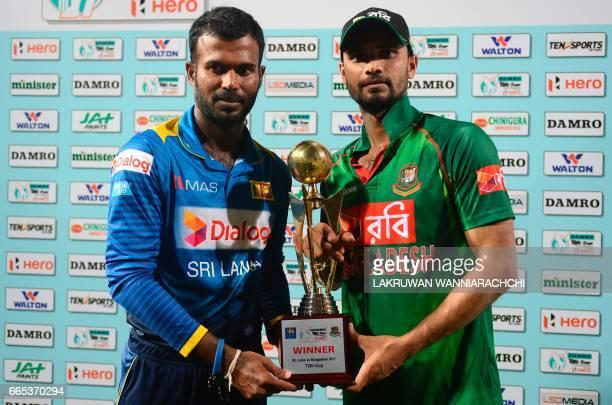 Sri Lankan captain Upul Tharanga and Bangladesh cricket captain Mashrafe Mortaza poses with the series trophy after the second T20 international...
