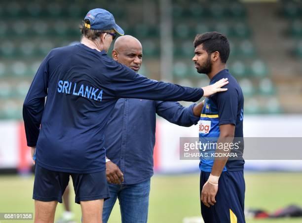 Sri Lankan chief cricket selector Sanath Jayasuriya and team coach Graham Ford speak with Niroshan Dickwella during a practice session at The Rangiri...