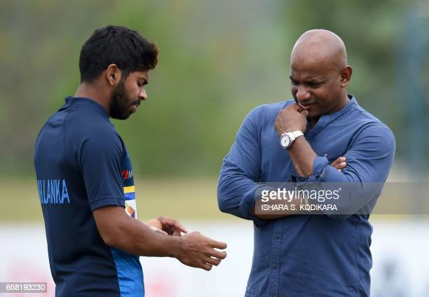 Sri Lankan chief cricket selector Sanath Jayasuriya speaks with Niroshan Dickwella during a practice session at The Rangiri Dambulla International...
