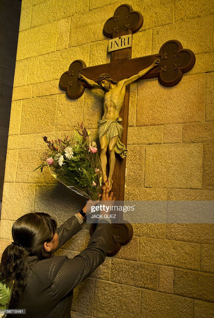 A Sri Lankan Christian pilgrim prays in the Nazareth's Basilica of the Annunciation built on the site where Christians believe Virgin Mary was told by the angel Gabriel that she would give birth to Jesus Christ, in the northern Arab-Israeli city of Nazareth on December 25, 2012. AFP PHOTO / JACK GUEZ