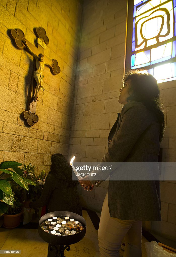 Sri Lankan Christian pilgrims pray in the Nazareth's Basilica of the Annunciation built on the site where Christians believe Virgin Mary was told by the angel Gabriel that she would give birth to Jesus Christ, in the northern Arab-Israeli city of Nazareth on December 25, 2012.