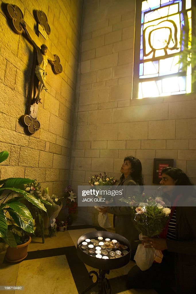 Sri Lankan Christian pilgrims pray in the Nazareth's Basilica of the Annunciation built on the site where Christians believe Virgin Mary was told by the angel Gabriel that she would give birth to Jesus Christ, in the northern Arab-Israeli city of Nazareth on December 25, 2012. AFP PHOTO / JACK GUEZ