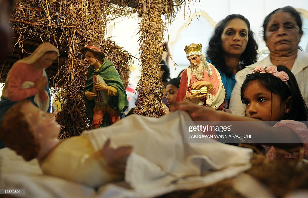 Sri Lankan Christians gather around a nativity scene depicting the birth of Jesus during a Christmas mass in Colombo on December 25, 2012. Christians account for some six percent of Sri Lanka's 20 million people.
