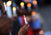Sri Lankan civil society activists hold candles and placards during a vigil for missing cartoonist and journalist Prageeth Eknaligoda in Colombo on...