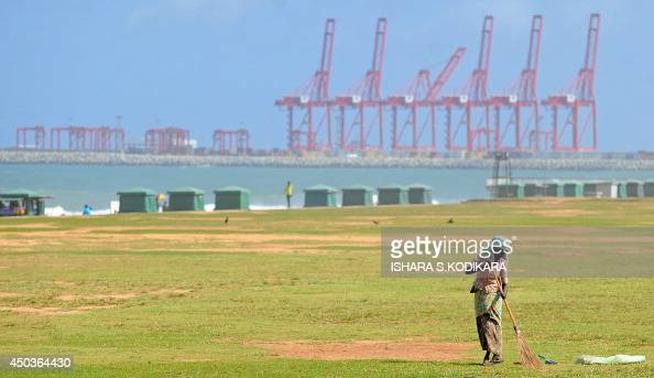 A Sri Lankan cleaner sweeps the ground at the Galle Face Green in Colombo on June 10 2014 Sri Lanka's economy recorded 80 percentplus growth for two...