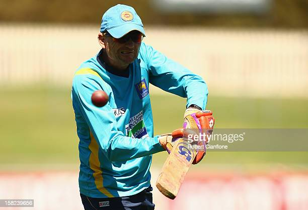 Sri Lankan coach Graham Ford hits the ball during a Sri Lanka nets session at Blundstone Arena on December 12 2012 in Hobart Australia