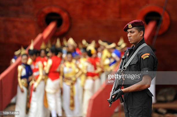 A Sri Lankan commando stands guard at the construction site of a newly built port of Hambantota on August on 15 2010 Sri Lanka President Mahinda...