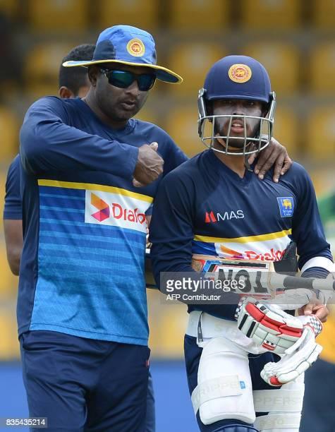 Sri Lankan cricket batting coach Avishka Gunawardene instructs player Kusal Mendis during a practice session at the Rangiri Dambulla International...
