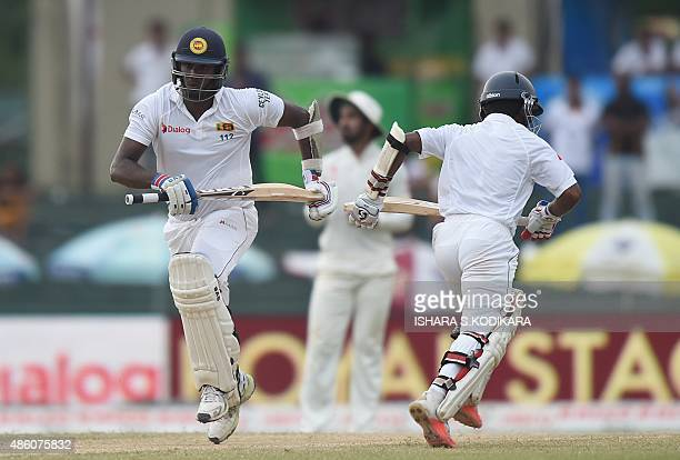 Sri Lankan cricket captain Angelo Mathews and Kaushal Silva run between the wickets during the fourth day of their third and final Test cricket match...