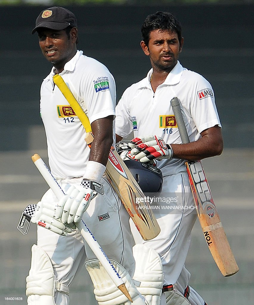 Sri Lankan cricket captain Angelo Mathews (L) and Lahiru Thirimanne leave the grounds with the stumps following their team's victory in the second Test match between Sri Lanka and Bangladesh at the R. Premadasa Cricket Stadium in Colombo on March 19, 2013. Sri Lanka beat Bangladesh by seven wickets on the penultimate day of the second and final Test in Colombo on Tuesday to clinch the series 1-0.