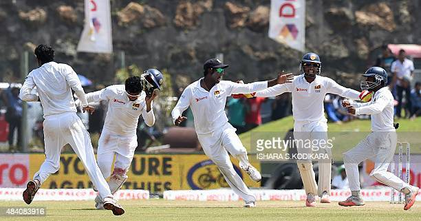 Sri Lankan cricket captain Angelo Mathews and teammates celebrate after victory on the fourth day of the opening Test match between Sri Lanka and...