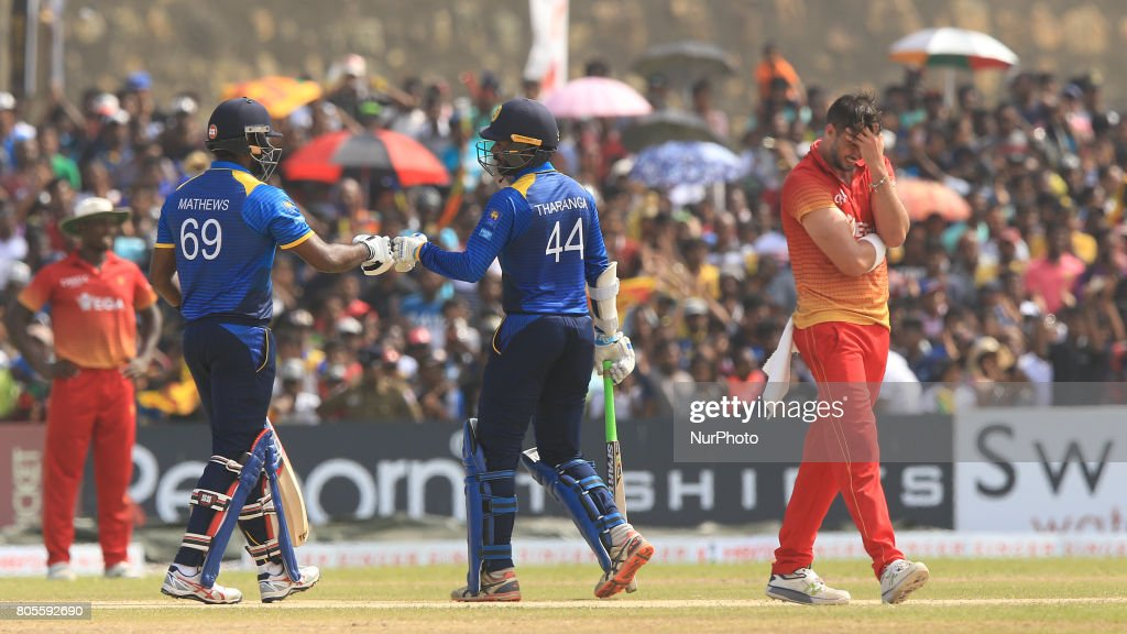Sri Lankan cricket captain Angelo Mathews and Upul Tharanga tap their gloves as Zimbabwe captain Graeme Cremer(R) reacts during the 2nd One Day International cricket match at Galle International cricket stadium, Galle, Sri Lanka on Sunday 2nd July 2017