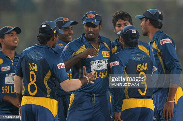 Sri Lankan cricket captain Angelo Mathews celebrates with teammates after winning the second OneDay International cricket match between Bangladesh...
