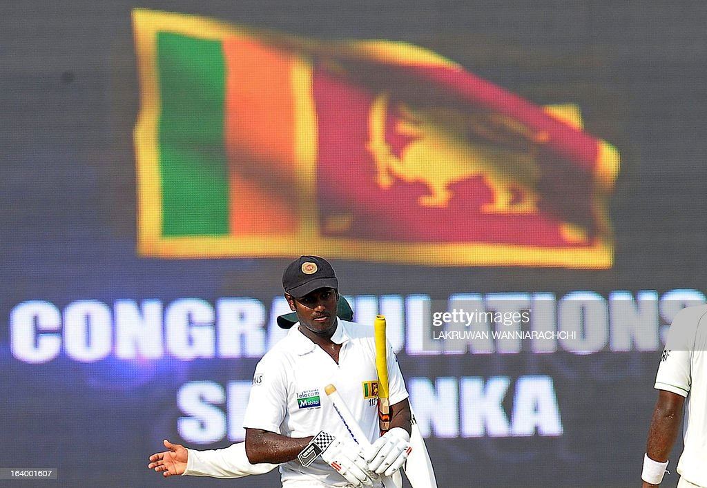 Sri Lankan cricket captain Angelo Mathews leaves the grounds with the stumps following his team's victory in the second Test match between Sri Lanka and Bangladesh at the R. Premadasa Cricket Stadium in Colombo on March 19, 2013. Sri Lanka beat Bangladesh by seven wickets on the penultimate day of the second and final Test in Colombo on Tuesday to clinch the series 1-0.
