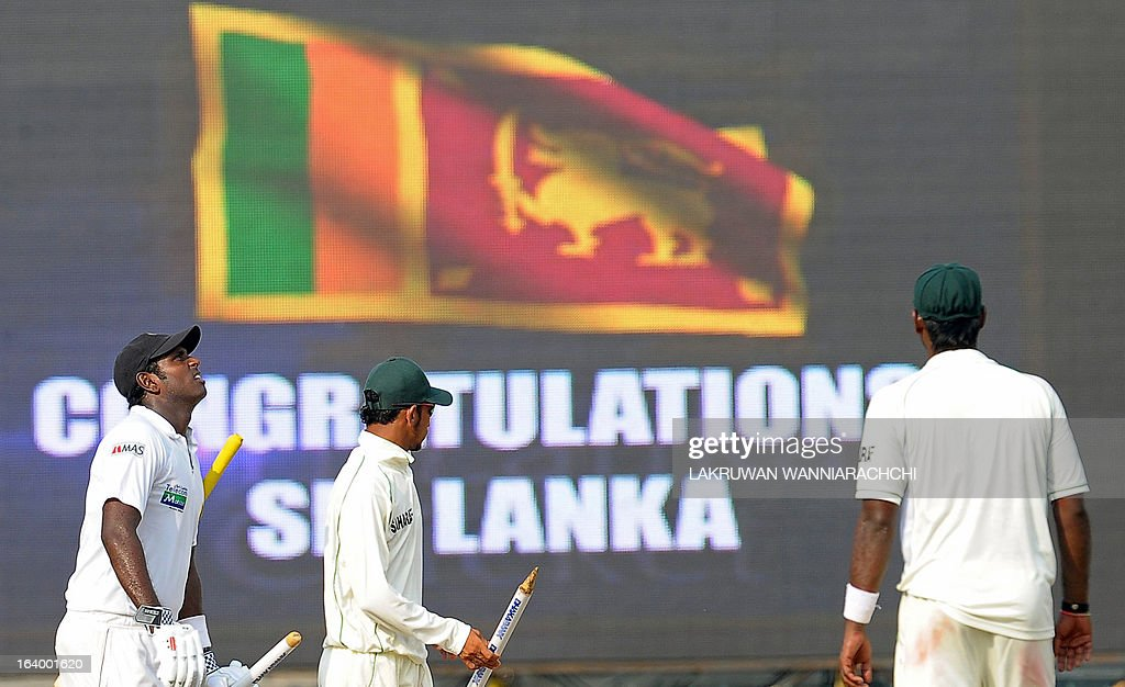 Sri Lankan cricket captain Angelo Mathews (L) leaves the grounds with the stumps following his team's victory in the second Test match between Sri Lanka and Bangladesh at the R. Premadasa Cricket Stadium in Colombo on March 19, 2013. Sri Lanka beat Bangladesh by seven wickets on the penultimate day of the second and final Test in Colombo on Tuesday to clinch the series 1-0.