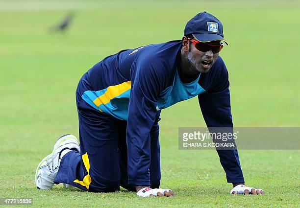 Sri Lankan cricket captain Angelo Mathews looks on during a practice session at the Galle International Cricket Stadium in Galle on June 15 2015 Sri...