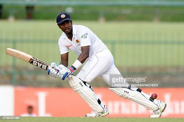 Sri Lankan cricket captain Angelo Mathews plays a shot during the third day of the third and final Test cricket match between Sri Lanka and Pakistan...