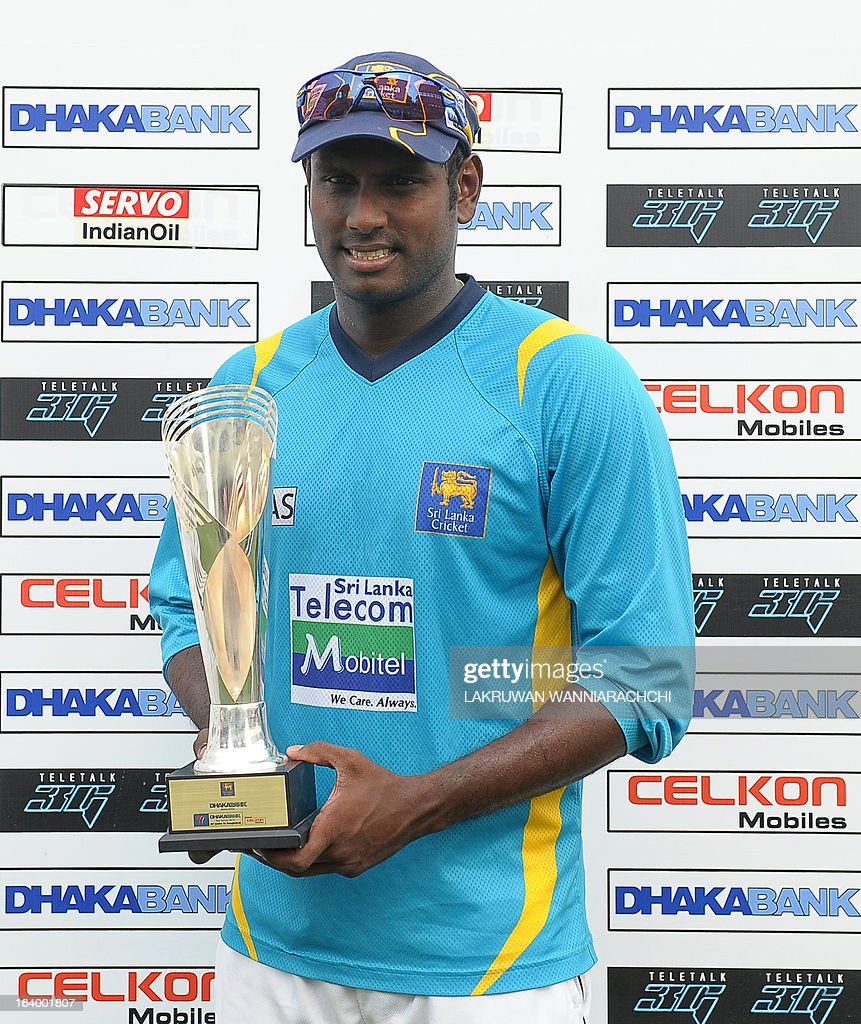 Sri Lankan cricket captain Angelo Mathews poses with the trophy after his team's victory in the second Test match between Sri Lanka and Bangladesh at the R. Premadasa Cricket Stadium in Colombo on March 19, 2013. Sri Lanka beat Bangladesh by seven wickets on the penultimate day of the second and final Test in Colombo on Tuesday to clinch the series 1-0.